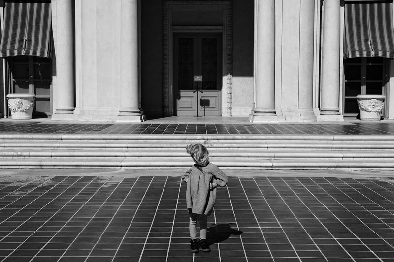 Young girl in front of building