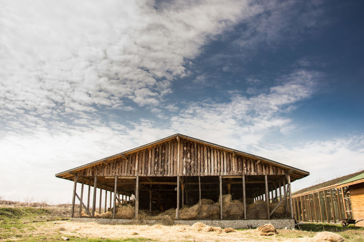 Low Angle View Of Barn Against Sky