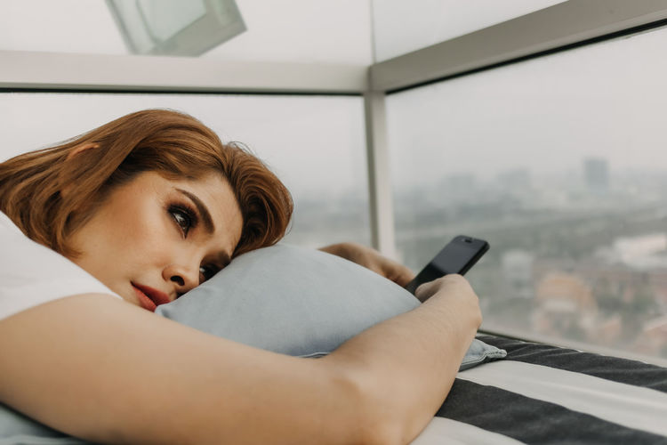 Portrait of woman relaxing on laptop at home