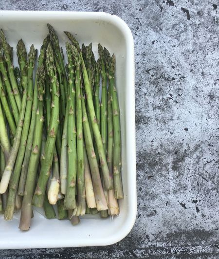 High angle view of asparagus in container on table