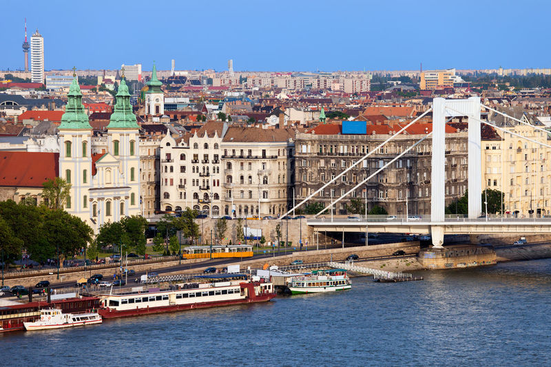 Cityscape of Budapest, Hungary with Inner City Parish Church, apartment houses and part of Elizabeth Bridge Budapest Danube Hungary Inner City Parish Church Riverside Architecture Bridge Bridge - Man Made Structure Building Building Exterior Built Structure Capital Cities  Capital City City Cityscape Elizabeth Bridge Europe House Old Buildings River Travel Destinations Urban Urban Skyline Water Waterfront