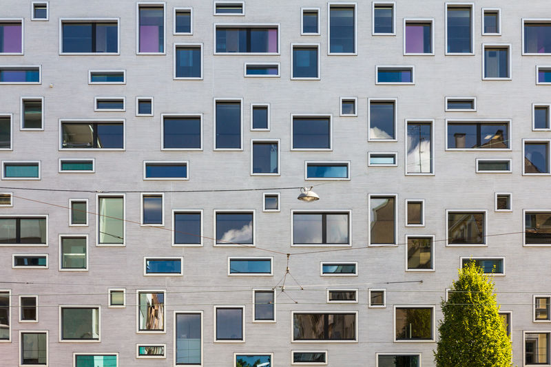 Street view Apartment Architecture Backgrounds Building Building Exterior Built Structure City Day Design Different Window Forms Full Frame House Housing Development In A Row Modern No People Outdoors Pattern Refelctions Within Building Repetition Residential District Window