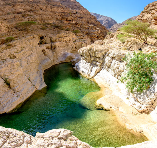 The Wadi As Shab is the most famous wadi where we can swim in clear water in the beautiful Sultanate of Oman. Arch Beauty In Nature Canyon Day Destination Eroded Formation Geology Lake Land Mountain Natural Arch Nature No People Non-urban Scene Outdoors Rock Rock - Object Rock Formation Scenics - Nature Solid Tranquil Scene Tranquility Travel Water