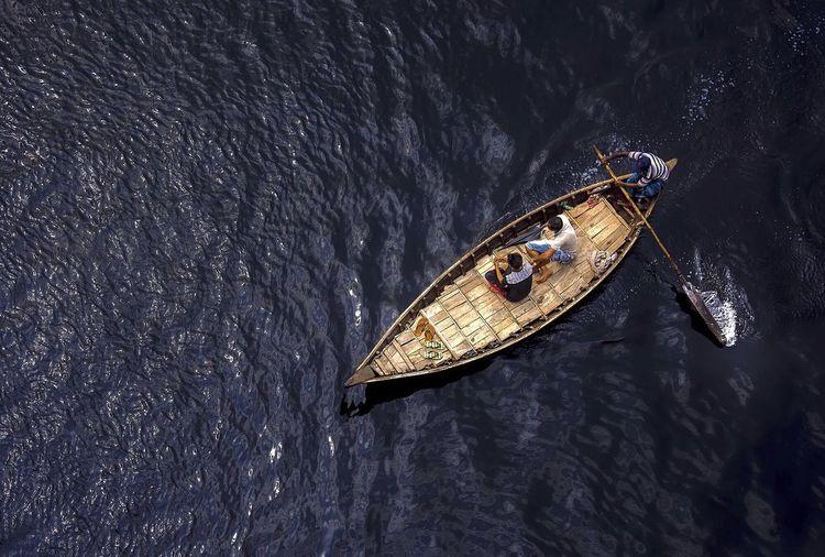 High Angle View Of Men Sailing Boat On Buriganga River