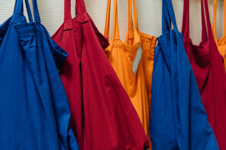 Multi colored bags hanging on wall