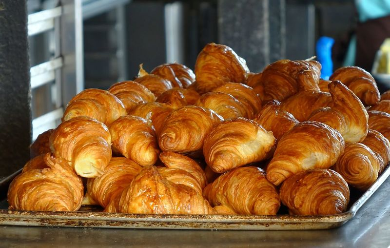 Close-up of fresh croissants in baking tray