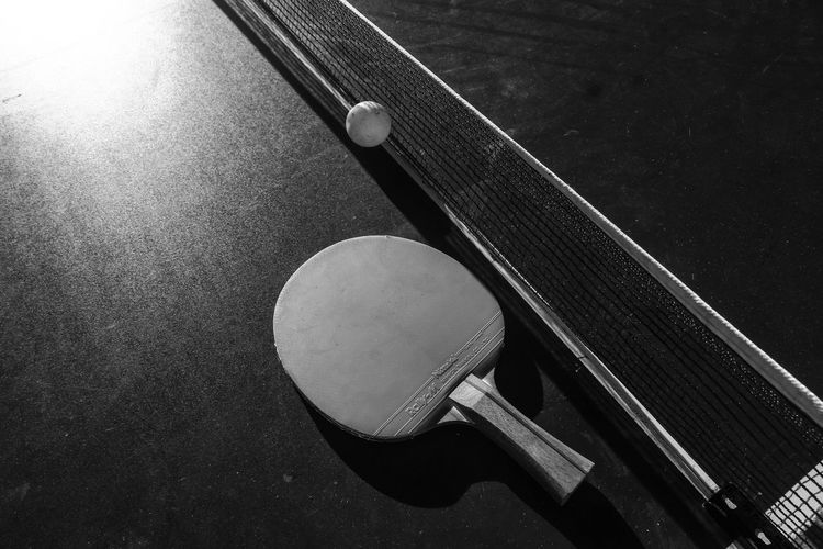 Close-up of table tennis paddle and ball