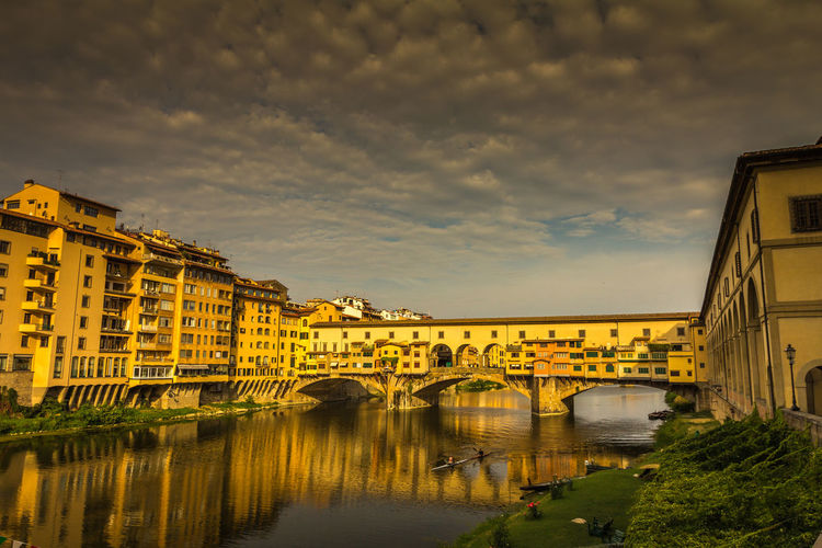 Ponte Vecchio in Florence Italy Florence Florence Italy Florence, Italy Firenze Firenze, Italy Ponte Vecchio Arno River Arno  Built Structure Architecture Bridge Water Bridge - Man Made Structure Building Exterior Connection Sky Cloud - Sky Transportation River Nature Building Arch Bridge No People Waterfront City Reflection Arch Outdoors
