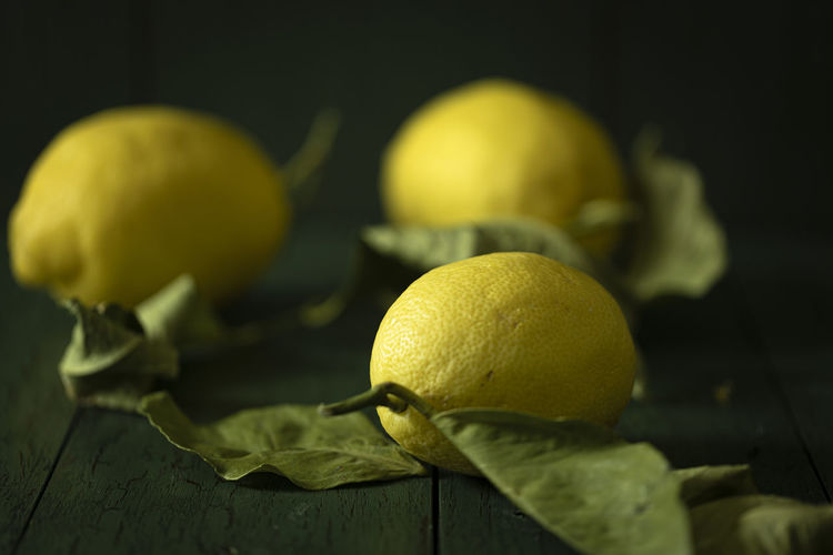 Close-up of yellow fruit on table