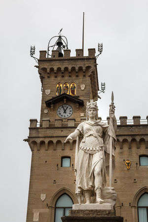 Statue of Liberty (Statua della Libertà) and Town Hall on Palazzo Pubblico square in San Marino Palazzo Pubblico San Marino Statue Architecture Belief Building Building Exterior Built Structure Clear Sky Clock Clock Face Clock Tower Day History Low Angle View Nature No People Representation Sculpture Sky The Past Time Tower Travel Destinations Uhrturm