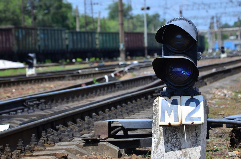 Close-up of signal by railroad track