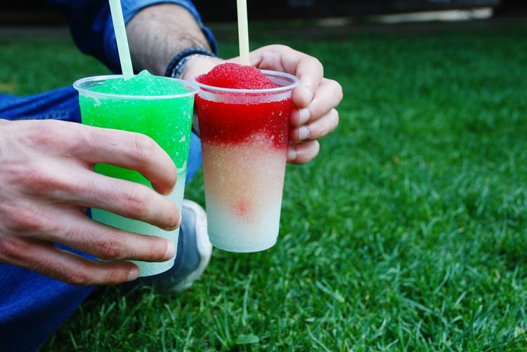 Slush Colorful Food And Drink Lights Sun Square Platz Grass Park Relax Shades Human Hand Hand Nature Plant Day Adult Focus On Foreground Red Healthy Eating Leisure Activity Drink Freshness Outdoors