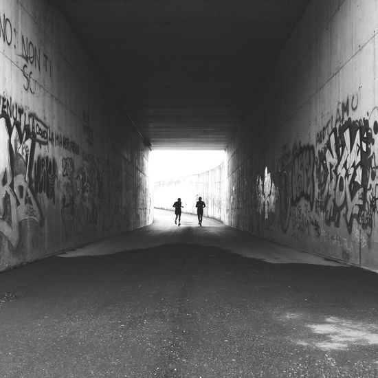 I fortuitously met two running Silhouettes in this dark Subway along a Cycling lane. I love the look of the wall paintings and how they stand out even though the picture is Black And White , giving the perfect Urban touch for a Streetphotography . Wall Art