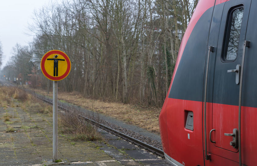 Mobility In Mega Cities No Entry Pirschheide Public Transportation Sign Communication Day Nature No People Not Allowed Outdoors Public Transport Public Transportation Rail Transport Rail Transportation Railroad Track Red Road Sign Sky Stop Train Transportation Tree