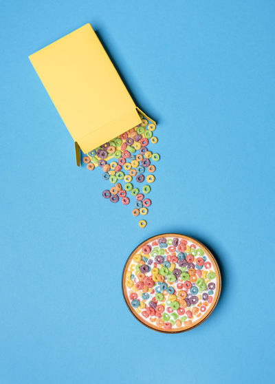 Directly above shot of multi colored candies against blue background