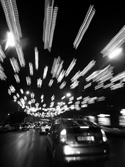 Rushing into New Year. Blackandwhite Blackandwhite Photography Bw Bw_collection Streetphotography Street Photography Reflection Illuminated Night No People Outdoors Sky AI Now Mobility In Mega Cities