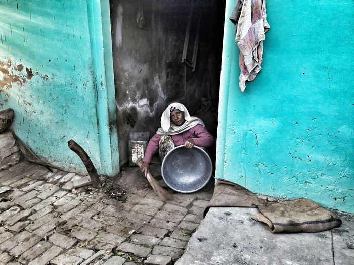 High angle view of woman cleaning on doorway
