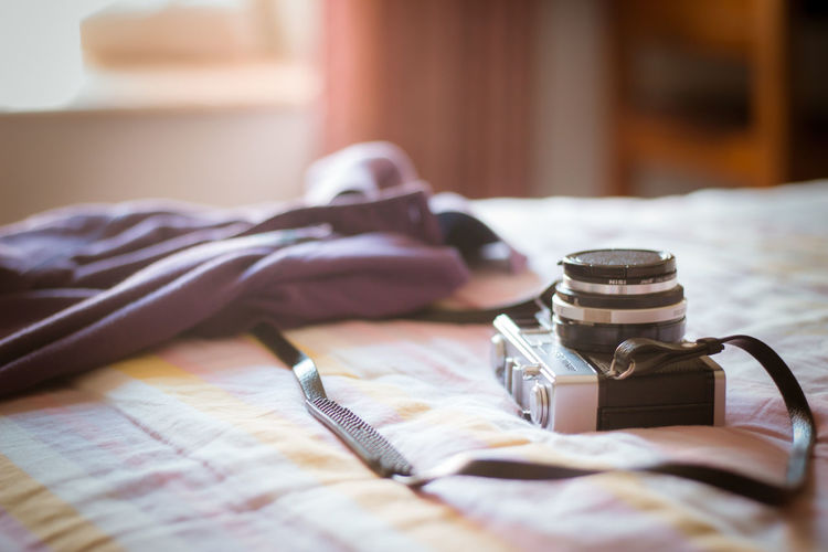 Camera with towel on bed