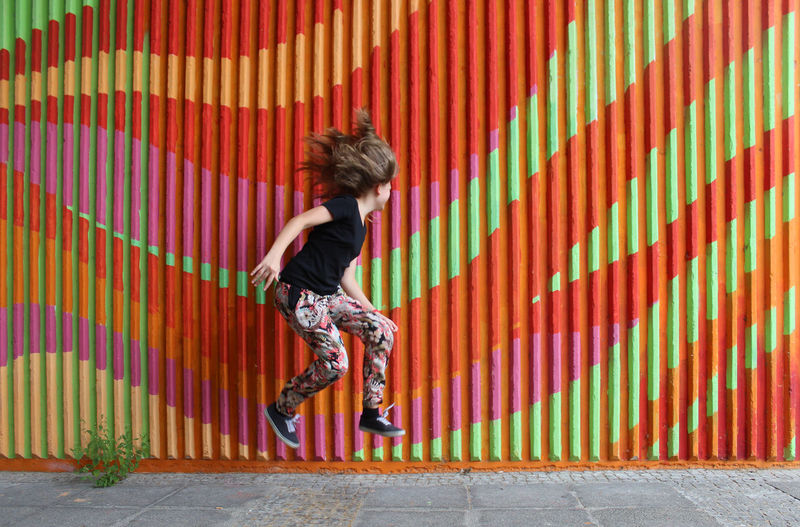 Jump Action Black Coloured Fitness Freedom Fun Graffiti Hair Jump Jumping Street Streetphotography Wall - Building Feature Youth Youth Culture Adapted To The City EyeEmNewHere The Street Photographer - 2017 EyeEm Awards