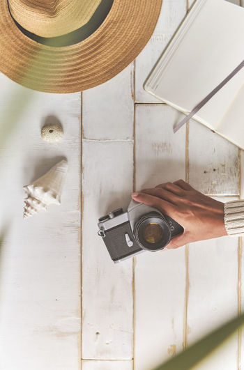 Man photographing with camera on table