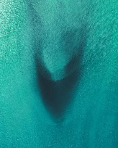 Full frame shot of blue paint on green background