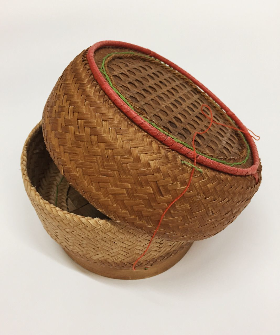 High Angle View Of Wicker Basket Against White Background