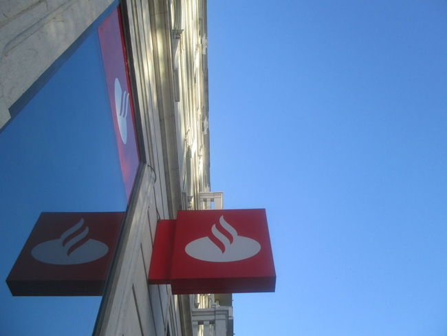 #architecture #Blue #building #City #mirror #reflection In The Mirror #reflection In The Window #symetry Architecture Blue Blue Sky Clear Sky Close-up Communication Day Guidance Low Angle View No People No People, Outdoors Red Reflection Road Sign Santander Bank In Lisbon Sky