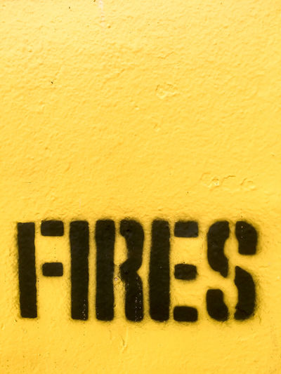 Fires stencilled in black paint on yellow background Background Black Close-up Copy Space Detail Fire Fires Letters Notice Paint Painted Print Printed Sign Stencil Stencilled Text Warning Word Yellow