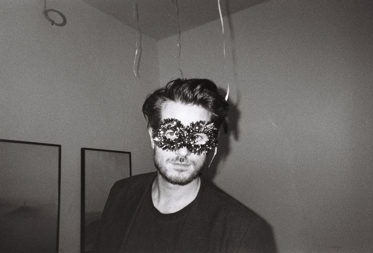 Close-up portrait of man wearing eye mask