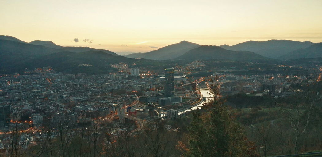 panoramic view of the city of Bilbao Beauty In Nature City Cityscape Elevated View Growth Hill Horizon Over Land Idyllic Illuminated Landscape Mountain Mountain Range Nature No People Orange Color Outdoors Residential District Scenics Sky Sunset Town TOWNSCAPE Tranquil Scene Tranquility