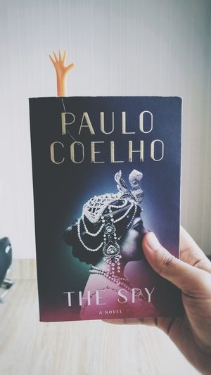 """Enchanting and intriguing story... Mata Hari is Indonesian word for """"Sun"""" Her name isn't as bright as her life... """"Her only crime was to be an independent woman"""" - Paulo Coelho Novel EyeEm Reading A Book Productive Time Indoors"""