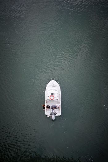 Directly Above Shot Of People Fishing In Boat On Sea