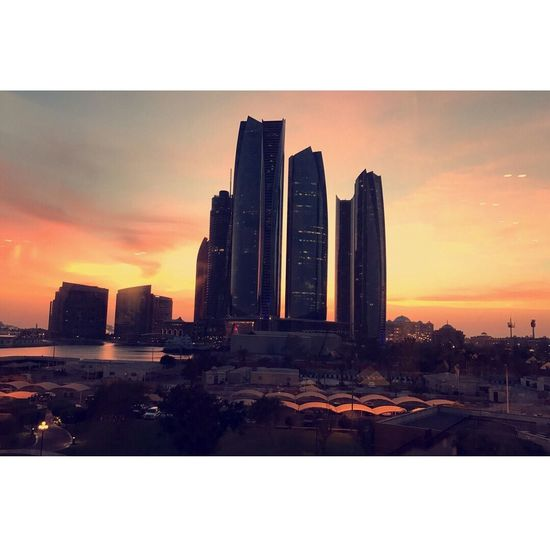Sunset Skyscraper Architecture Building Exterior Built Structure City Sky Cityscape Urban Skyline No People Outdoors Modern Growth Water Nature Day Ethihad Towers Abudhabi Abu Dhabi Travel Destinations Architecture Tall - High