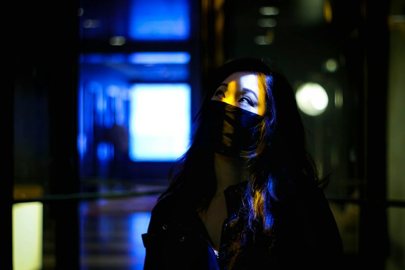 Close-up portrait of woman with illuminated lights