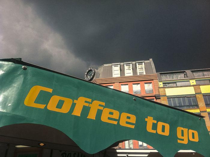 'Coffee to Go' sunshade at Hackerscher Markt 'Coffee To Go' Buildings Communication Green Hackerscher Markt Information Sign STAND Symbol Text Yellow