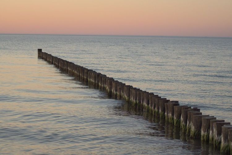 Algen An Der Bohle Ruhe Weite Sunset Scenics Horizon Over Water Water In A Row Tranquil Scene No People Beach Tranquility Beauty In Nature The Way Forward Nature Outdoors Sky Groyne Day Ruhe
