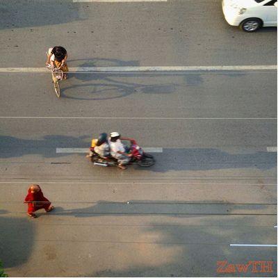 Morning. pedistarian on 22C Road, Mandalay. Road Pedistrian Monk  Bike Bicycle Shadow Lane Mandalay Myanmar Burma Myanmarphotos Exploremyanmar Goldenland Igersmyanmar Igersoftheday Igersmandalay Burmeseigers Mycapture Ig_global_life GalaxyGrand2 Zawth
