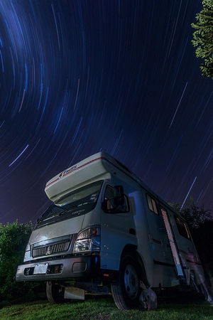 E pur si muove HUAWEI Photo Award: After Dark Astronomy Blurred Motion Commercial Land Vehicle Land Vehicle Long Exposure Mode Of Transportation Motion Motor Vehicle Nature Night No People Scenics - Nature Semi-truck Sky Space Star Star - Space Star Trail Transportation Truck Trucking Wheel