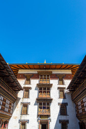 ASIA Dzong Travel Architecture Belief Bhutan Blue Buddhism Building Built Structure Clear Sky Copy Space Day History Low Angle View Nature No People Ornate Place Of Worship Religion Sky Spirituality Tourism Travel Destinations