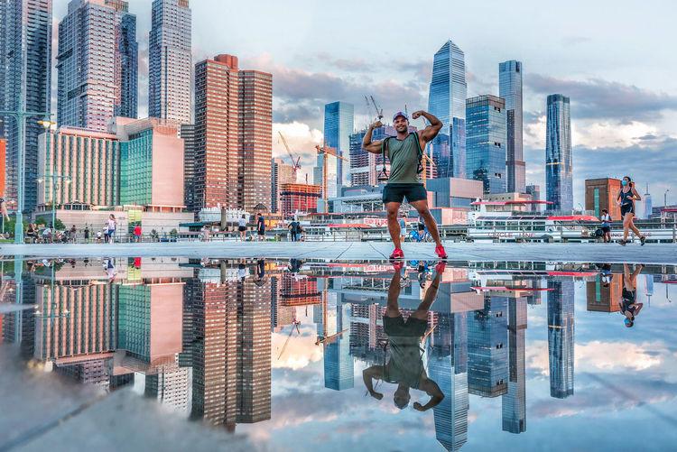 Digital composite image of modern buildings against sky in city