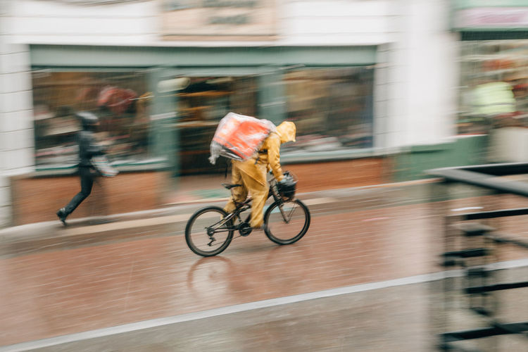 Rain Raining Rainy Days Rainy Season Rainy City City Bogotá Colombia South America Latin America Motion Bicycle Blurred Motion Architecture Sport Transportation Full Length Building Exterior Ride Riding Real People Built Structure Men on the move One Person Lifestyles Day Mode Of Transportation Outdoors