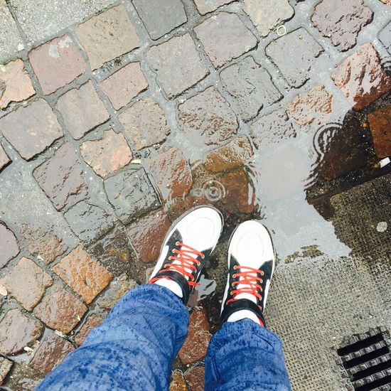 Wonder/rain Low Section Shoe High Angle View Standing Human Leg Personal Perspective Real People Outdoors One Person Cobblestone Day Leisure Activity Canvas Shoe Human Body Part People