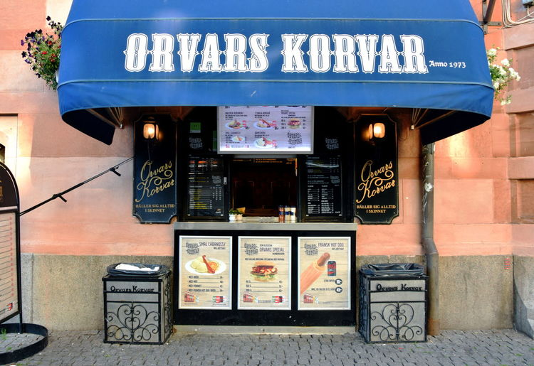 Hot dog stand. Fast Food Sweden Architecture Building Exterior Built Structure Business City Communication Day Fast Food Stand Food Food And Drink Footpath Hot Dog Stand Lighting Equipment No People Outdoors Restaurant Script Sign Snack Store Text Vending Machine