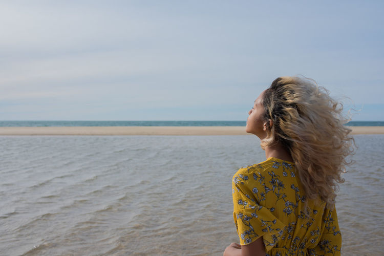 Ponder Beach Beauty In Nature Hair Hairstyle Horizon Horizon Over Water Land Leisure Activity Lifestyles Long Hair Looking At View One Person Outdoors Real People Scenics - Nature Sea Sky Standing Water Women