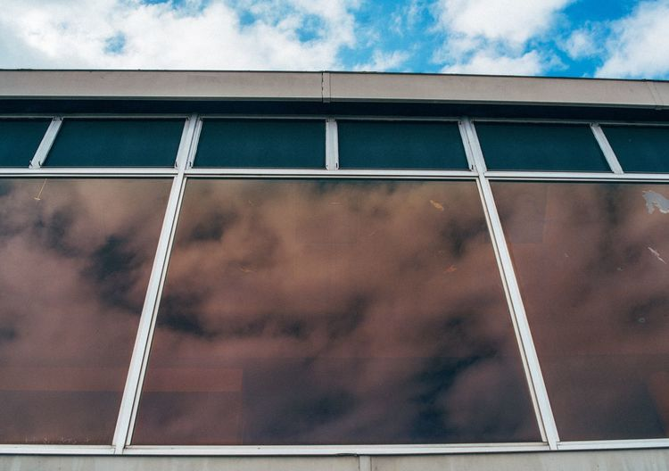 Low angle view of glass window against building