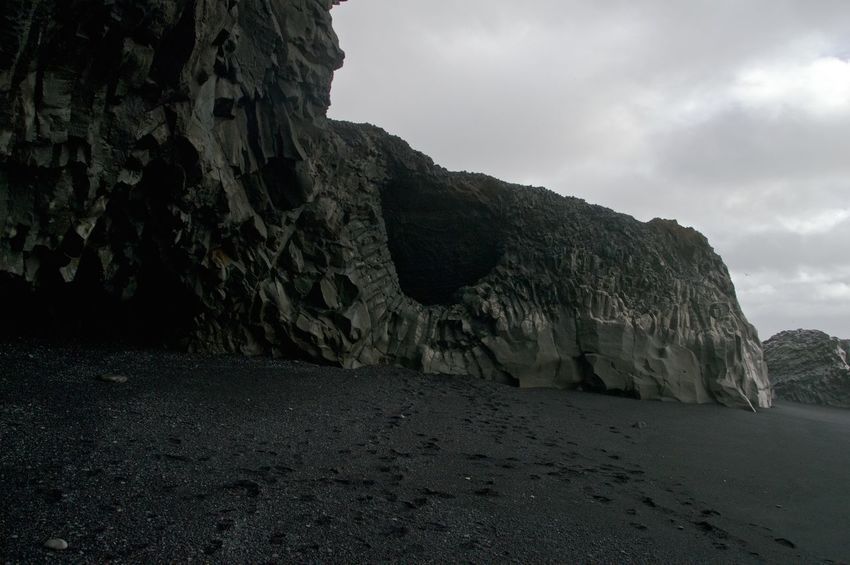 Basalt Basalt Columns Basalt Rock Black Beach Black Sand Black Sand Beach Geology Hole Hole In The Wall Iceland Layers Nature Photography No People Overcast Physical Geography Red Rocks  Roadtrip With The Cousins Rock Rock Formation Rocky Rough Seaside Textured  Travel Photography Trip