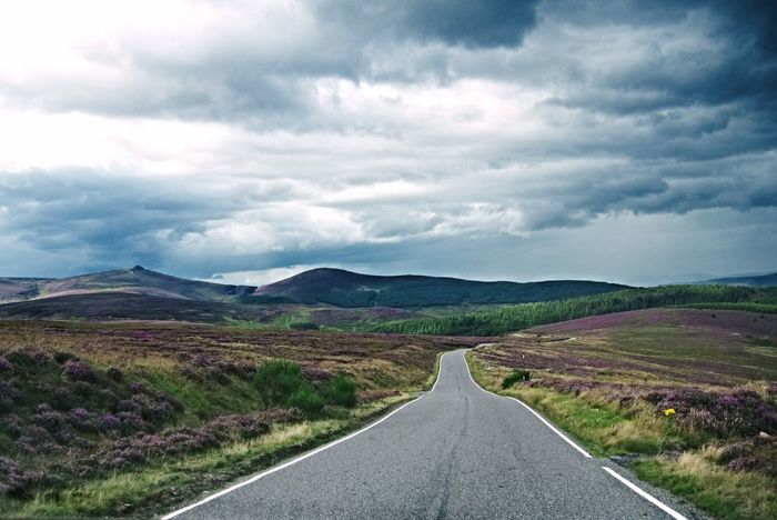 Clachnaben The Way Forward Road Landscape Scenics Outdoors No People Cloud - Sky Beauty In Nature Day Nature Mountain Winding Road Rural Scene Scotland Aberdeenshire Cairn O Mount Clachnaben Mountain Range Purple Heather Scottish Heather Purple Sky Road Hill Tree