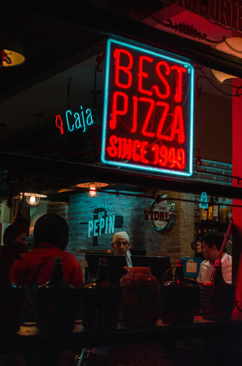 Best Pizza Sign , San Telmo, Buenos Aires Text Illuminated Group Of People Night Communication Sign Real People Built Structure Architecture City Men Building Exterior Adult Women Western Script Restaurant People Lifestyles Neon Food And Drink EyeEm Best Shots EyeEm Selects Streetphotography