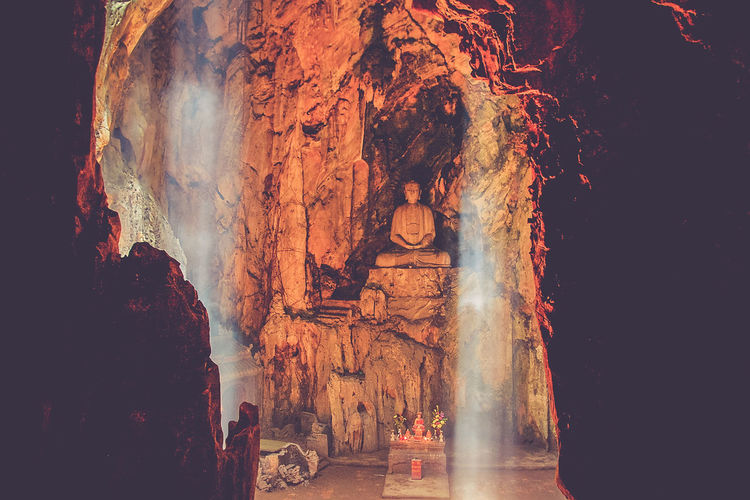 Lights and shadows in a buddhist temple inside a cave Backgrounds Buddhism Buddhist Cave Formations Indoors  Lights No People Outdoors Shadow Standing Statue Travel Travel Destinations Travel Photography Traveling Travelling Vietnam