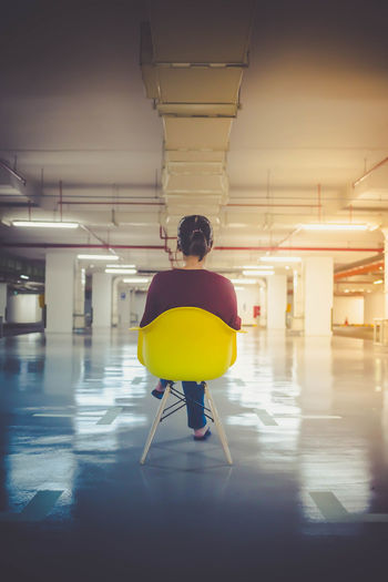 Items required for random fun - Yellow Chair - Empty Carpark - Camera Chair Empty Carpark Illuminated Indoors  One Person One Person Only Parking Garage People Real People Rear View Underground Car Park Woman Yellow Yellow Chair #urbanana: The Urban Playground International Women's Day 2019